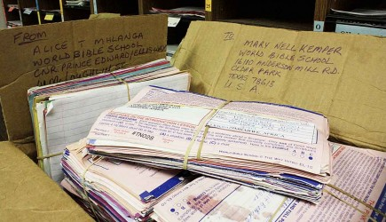 Hundreds of completed World Bible School lessons from Zimbabwe wait in the minstry's Texas office to be sent to teachers in the correspondence program spread across the U.S. – PHOTO BY ERIK TRYGGESTAD