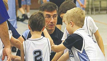 Players Hogan Sedlock and Bryan Beasley confer with coach Ted Rogers. – PHOTO BY MARK PRINCE