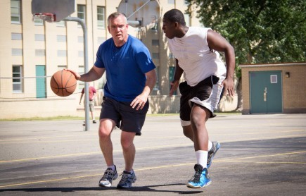 Bear Valley minister Neal Pollard dribbles the basketball during recreation time at the camp. He's guarded by Jabari Lance from the Lake Norman Church of Christ in Huntersville