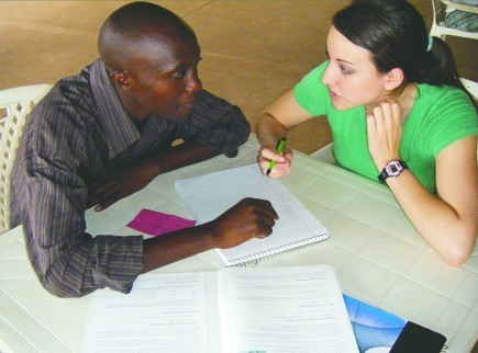Shanna Sanders practices English with a Ugandan in Kampala