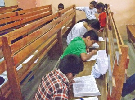 Children study the Bible in Lima