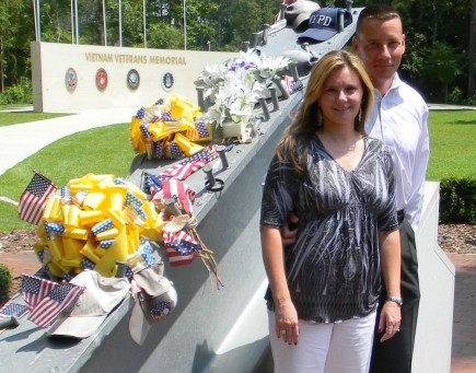 Mike and Kimberly Manning stand beside a steel beam from the World Trade Center. The memorial near Camp Lejeune