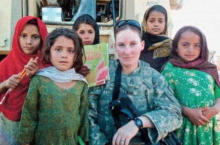 Army Staff Sgt. Jeanene Pollard pauses for a photo with girls in the Surkh-Rod district of northern Afghanistan. – PHOTO PROVIDED