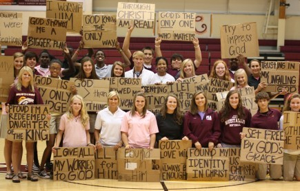 """Students at Madison Academy in Alabama share """"Cardboard Testimonies"""" at a recent chapel assembly at the school"""