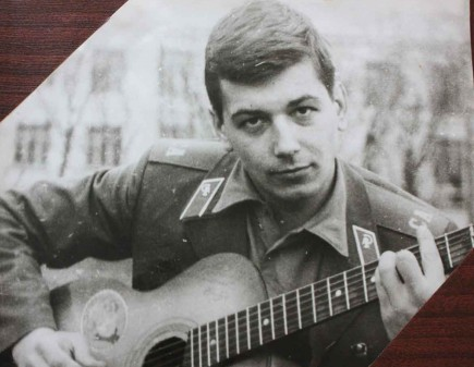 Sasha Prokopchuk poses with a guitar while serving in the Soviet army