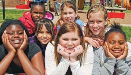 Kayla Bilby poses with some of the children she serves at the Contact Church of Christ in Tulsa