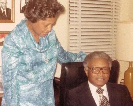Trailblazing church member Gladys Hawkins stands next to J.S. Winston