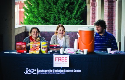 "Students involved with the campus ministry of the Jacksonville Church of Christ in Alabama are all smiles as they operate a ""free hot chocolate"" stand at Jacksonville State University. Whitney Gaut"
