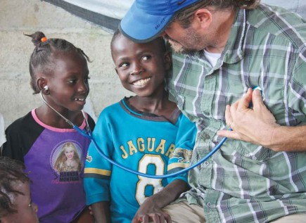 Medical missionary Darren Jones lets children listen to his heart during a visit to a home for special-needs children in Cap-Haitien