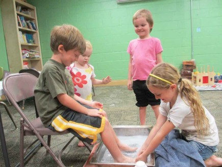 Liv Burkhardt washes the feet of Wade Rogers during a Wednesday night class at the Carrollton Avenue Church of Christ in New Orleans.