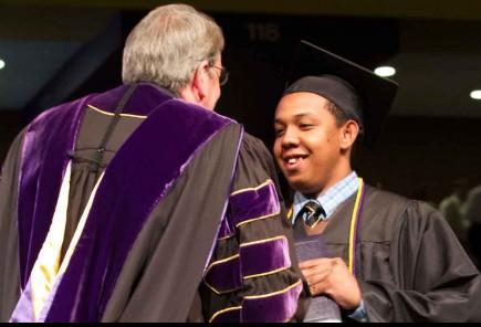 Joel Randrianasolomamonjy receives his degree May 5 from Randy Lowry
