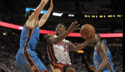 Norris Cole takes a shot in front of Thunder forward Nick Collison during Game 5 of the NBA Finals in Miami. – PHOTO PROVIDED BY MICHAEL LAUGHLIN