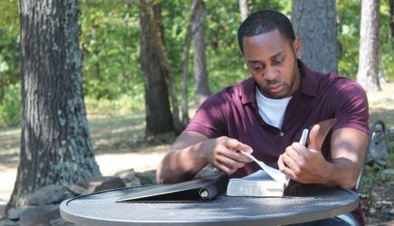 Grady Pettigrew studies his Bible at Crowley's Ridge College in Arkansas. – PHOTO BY CHRIS HUGHES