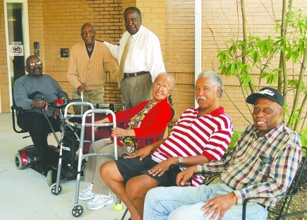 Minister David Jones visits residents at the Schrader Acres Assisted Living Center