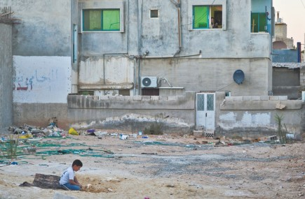 A child plays in Mafraq