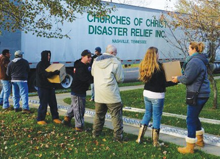 Volunteers with Churches of Christ Disaster Relief Effort load a truck with relief supplies. The West Islip Church of Christ in New York recently received one of the truckloads. The Nashville