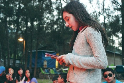 Victoria Jaramillo Hernandez shares notes she wrote while meditating on a chapter of the Gospel of John at the La Sierra Christian Camp near Aquiles