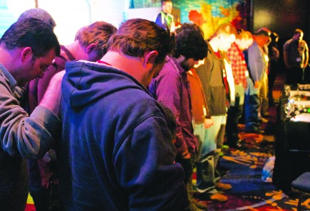 Veteran youth ministers pray for younger ministers during the National Conference on Youth Ministries.