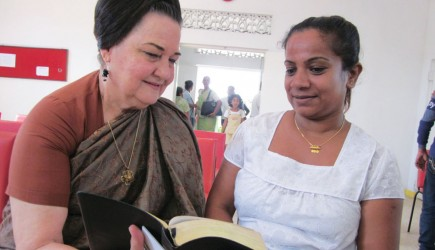 Betty Choate studies the Bible with a visitor at a Church of Christ in Colombo