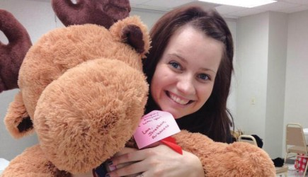 Meagan Cremeens shows off one of the stuffed animals collected. – photo provided