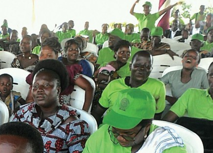 "Church members wear green shirts and hats as they celebrate 20 years of ""les Eglises du Christ"" (the Churches of Christ) in Benin. – photo provided by george akpabli"