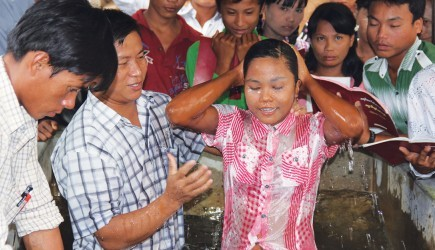 A woman smiles after her baptism in the delta region of Myanmar - one of 17 baptisms during a recent seminar. – Photo provided by Bill McDonough