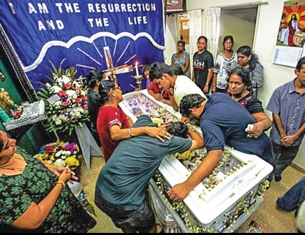 Mosharakini Arulandu's family - physical and spiritual - mourns at her memorial service. – PHOTO BY TOMMY CHIA