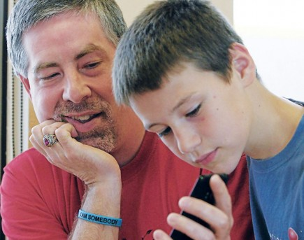 Murray and Conrad Evans view photos of Plaza Towers Elementary School in Moore