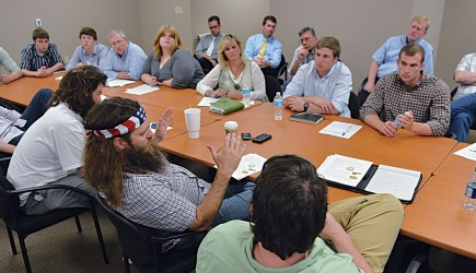 Willie Robertson visits with business students at Harding University in Searcy