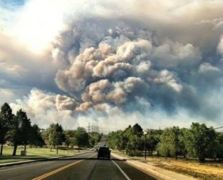 Larry Bertram of church-supported Orphans Lifeline International captured this view of the wildfires near his home in Monument