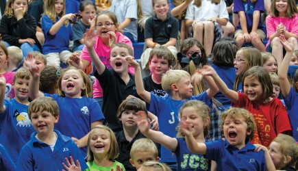 "The student body of Jackson Christian School in Tennessee celebrates the conclusion of the ""Power of One"" program. Students in kindergarten through 12th grade raised more then $14"