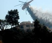 A helicopter battles blazes in the mountains that surround Pepperdine University. During the Oct. 21 fires