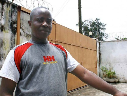 David Kolleh stands near the entry to a hotel in Monrovia