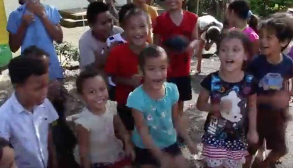 "Children in American Samoa sing ""Father Abraham."""