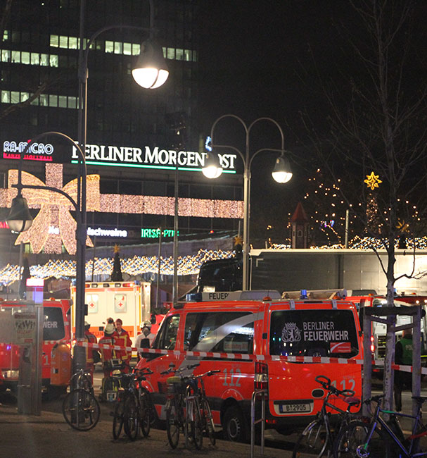 Emergency vehicles gather around the site of an attack on a Christmas market in Berlin.