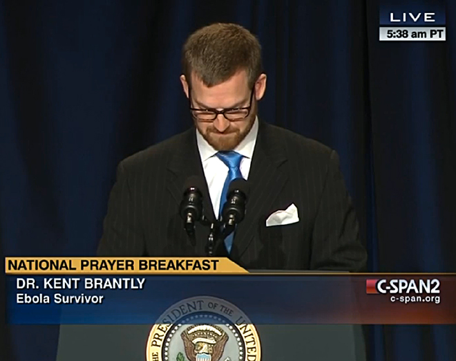 Dr. Kent Brantly leads a pray during the National Prayer Breakfast