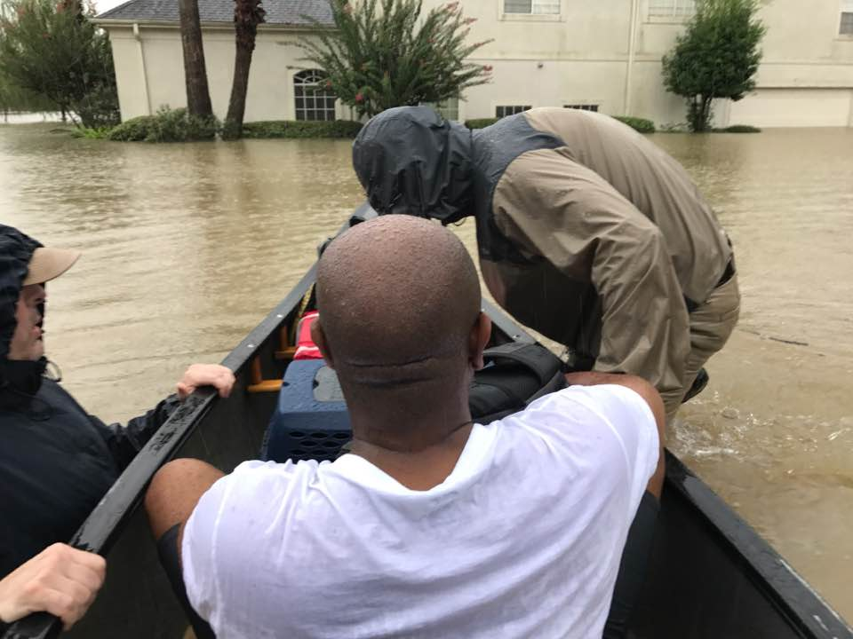 Church members came in a canoe to rescue Dwan Reed and her family from their home in Spring
