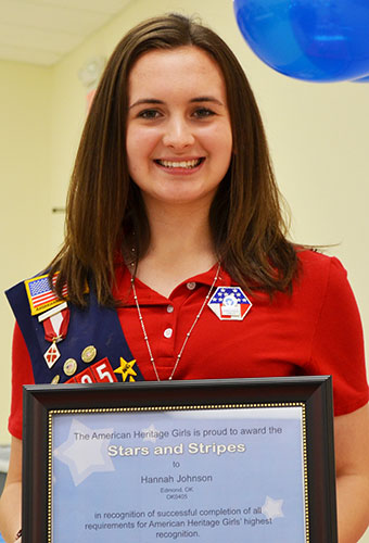Hannah Johnson displays her Stars and Stripes award