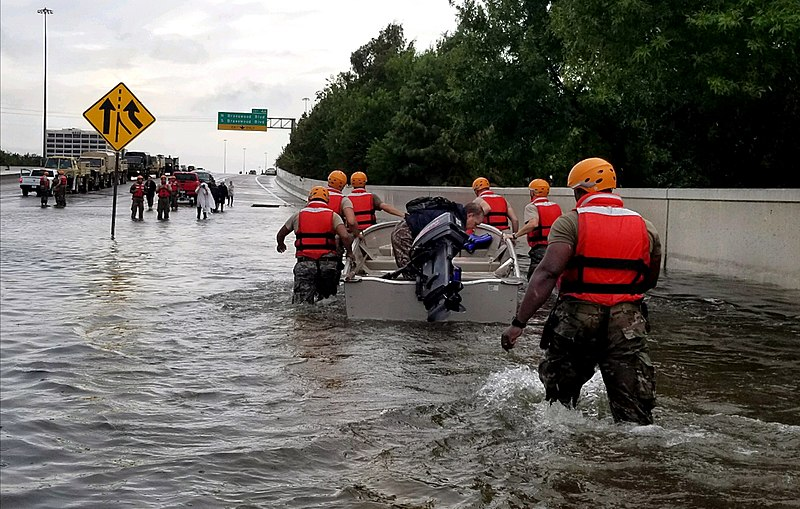 Texas Army National Guard soldiers move through Houston streets as floodwaters from Hurricane Harvey rise Aug. 28.