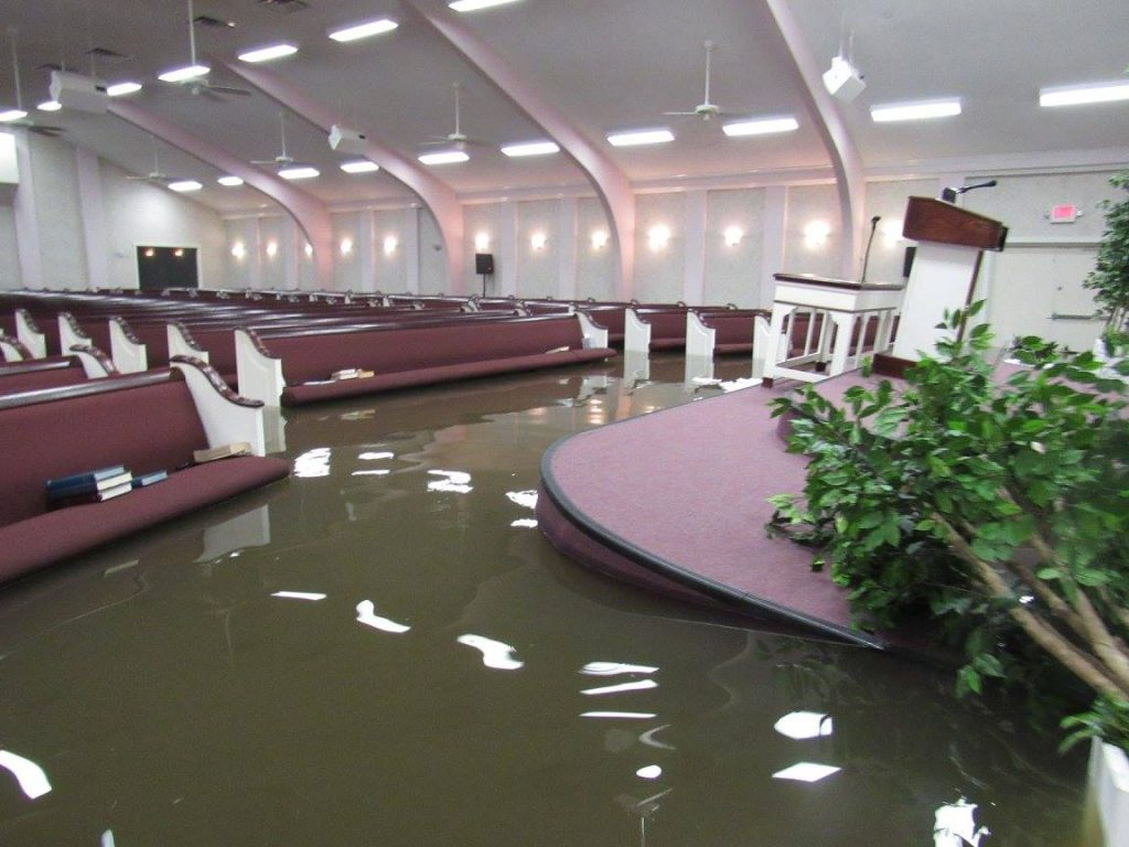 The auditorium at the Hidden Valley Church of Christ in Houston is filling with water as the rain continues to fall.
