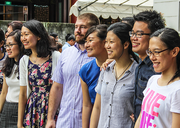 Young adult members of the Moulmein Church of Christ in Singapore pose for a photo during the church's farewell service. The congregation will demolish and rebuild its 55-year-old facility in this Southeast Asian city-state.
