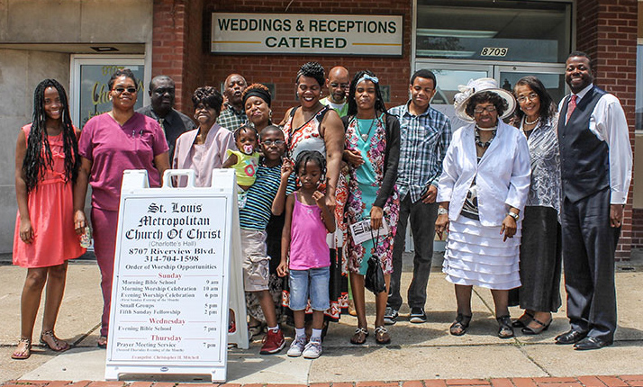 St. Louis Metropolitan Church of Christ members and children gather outside the congregation's temporary meeting place.