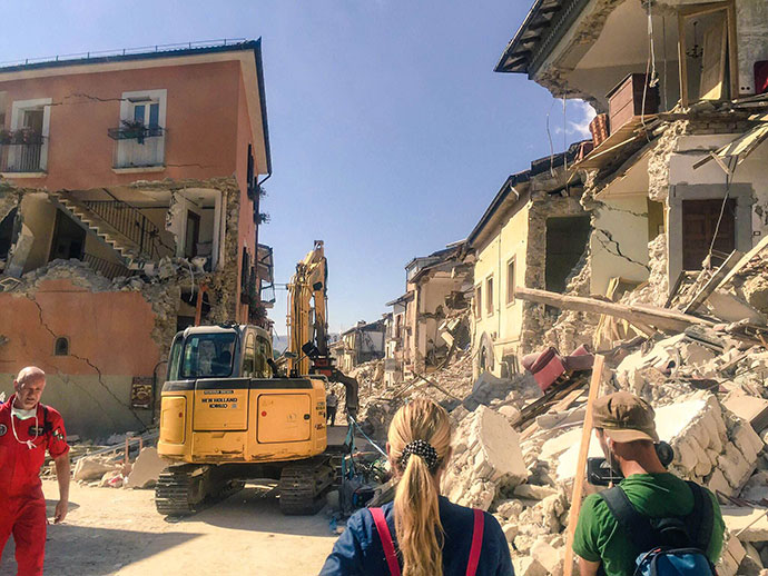 Rescuers work to free those trapped by a 6.2-magnitude earthquake in Amatrice