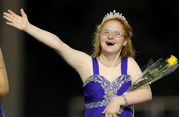 Emily Kendall waves to the crowd after receiving her homecoming queen crown at Mobile Christian School's homecoming game Sept. 26.