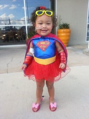 One of the first recipients of a superhero cape from the Kingwood Church of Christ members was a 2-year-old liver transplant patient. Church members learned about the patient through the congregation's medical apartment ministry.