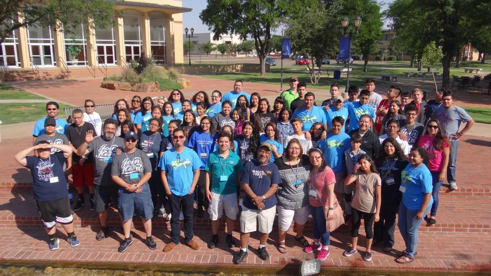 Nearly 100 campers and counselors pose for a group picture at the end of the inaugural National Hispanic English Youth Conference in Lubbock