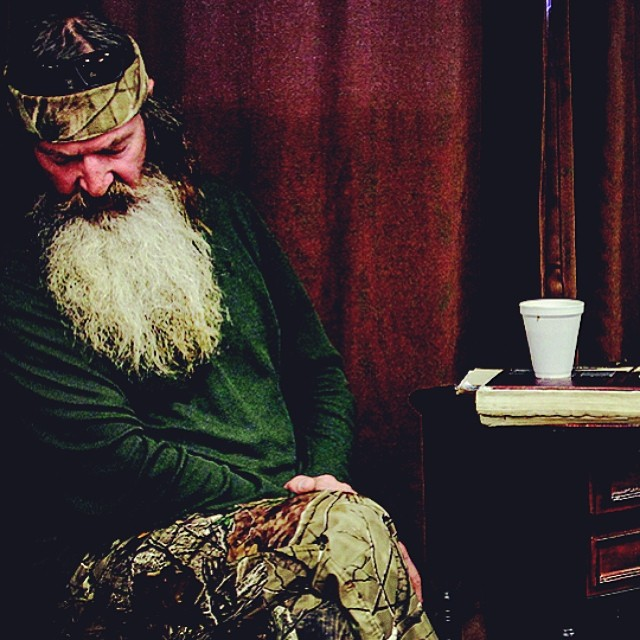 Phil Robertson prays at the end of a Sunday school class that he teaches at the White's Ferry Road Church of Christ in West Monroe