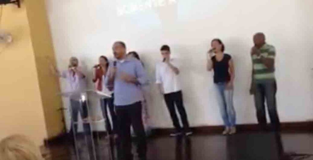 A church in Rio sings during a Sunday service.