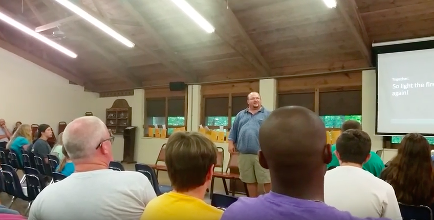 "Kip Green leads the Indian Creek Youth Camp's week four participants in the song ""Light the Fire"" during an evening devotional."
