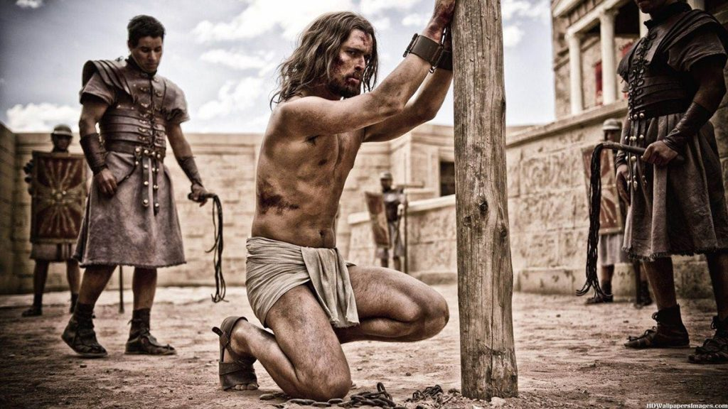 "Jesus (played by (Diogo Morgado) is beaten by Roman soldiers in ""Son of God."" The film"
